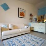 Art-7-tappeto-in-lana-panna-con-disegno-pavoncella-celeste-